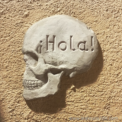 "Skull that says ""hola"" from street art in Barcelona"