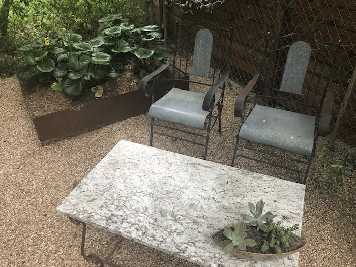 raised bed and metal furniture with succulents at French Place on Preservation Austin 2018 homes tour