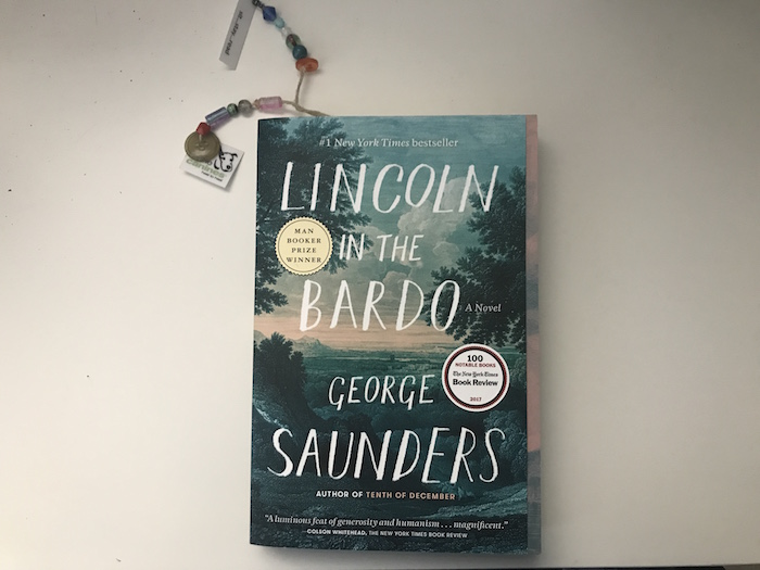 Book Lincoln in the Bardo by George Saunders with bookmarks