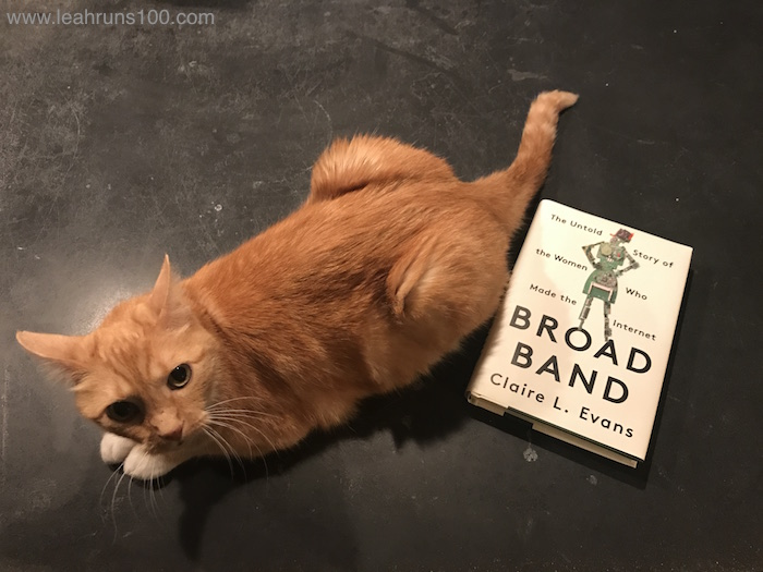 Cat next to copy of Broad Band: The Untold Story of the Women Who Made the Internet by Claire L. Evans
