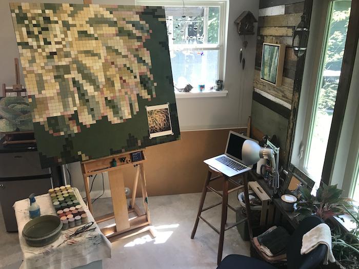 Interior view of Karen Alexander's studio with artwork in progress on easel