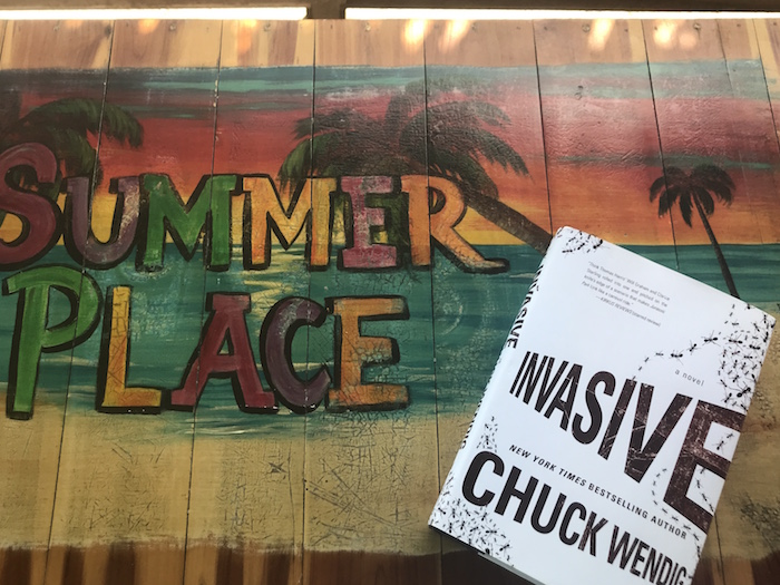 Copy of Chuck Wendig book Invasive with sign for Port Aransas house Summer Place