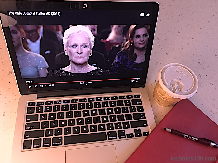 "Glenn Close still from ""The Wife"" trailer on laptop with writer's notebook and coffee"