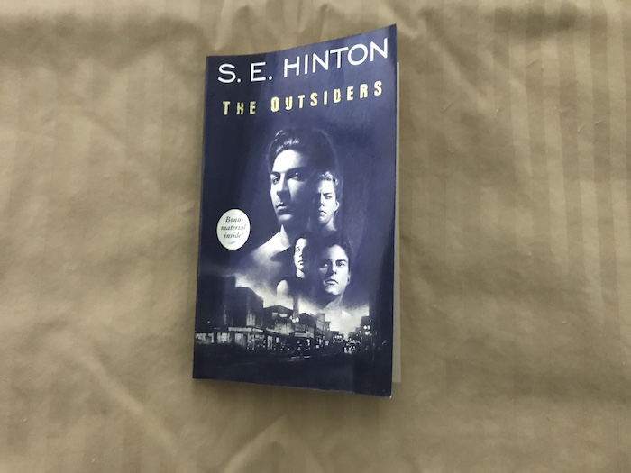 Paperback copy of S.E. Hinton's novel The Outsiders