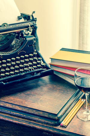 photo vintage typewriter with books and wine