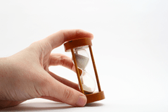Photo: Hand holding hourglass