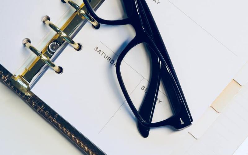 photo eye glasses on weekly planner copyright jess watters