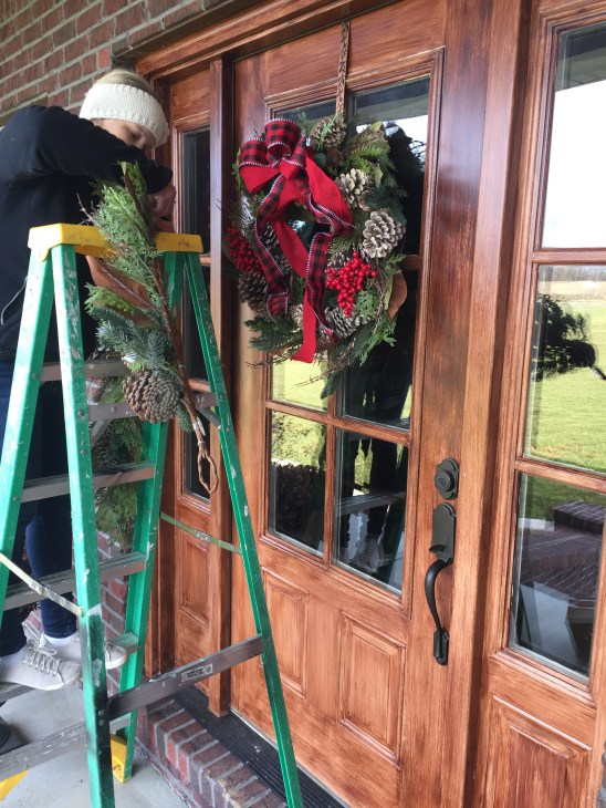 Christmas decorating | outdoor spaces | buffalo check ribbon | magnolia | Christmas decor | decorating | traditional Christmas