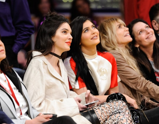 Watch Online   Kendall & Kylie Jenner Wear Thigh High Boots To Lakers Game