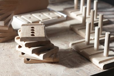 Some half finished stands on a table in the workshop