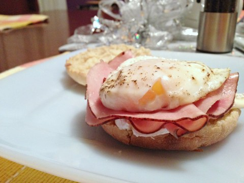 Egg sandwich with black forest ham and cheese on an English muffin