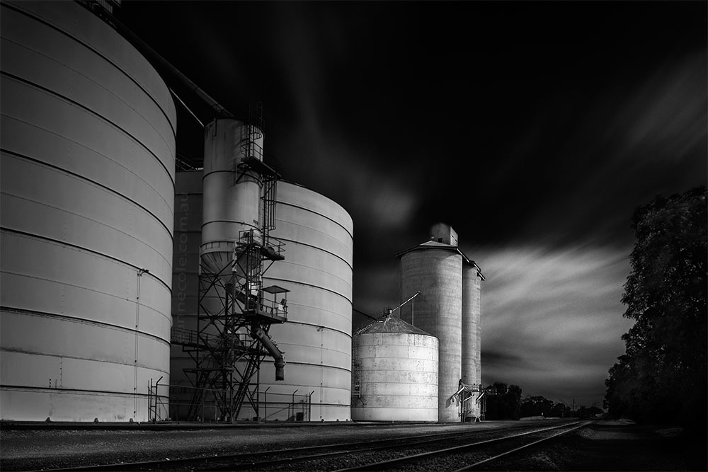 woomelang-silos-train-tracks-longexposure-monochrome