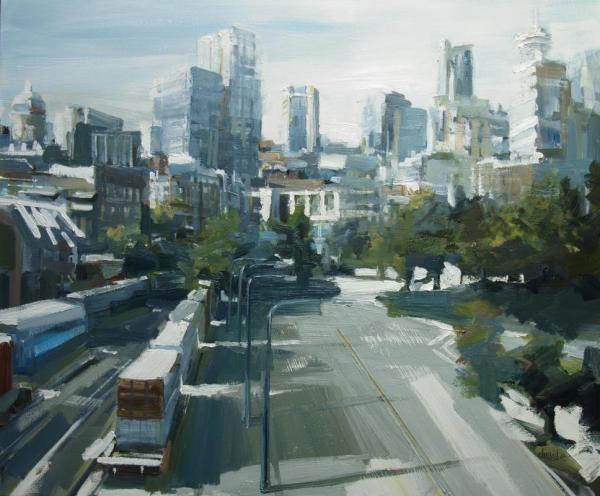 Cityscape from an overpass with train and road