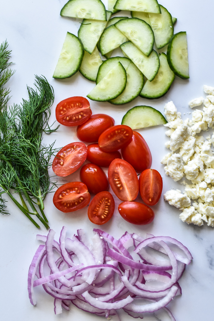 cucumbers, tomatoes, dill, feta cheese and red onions