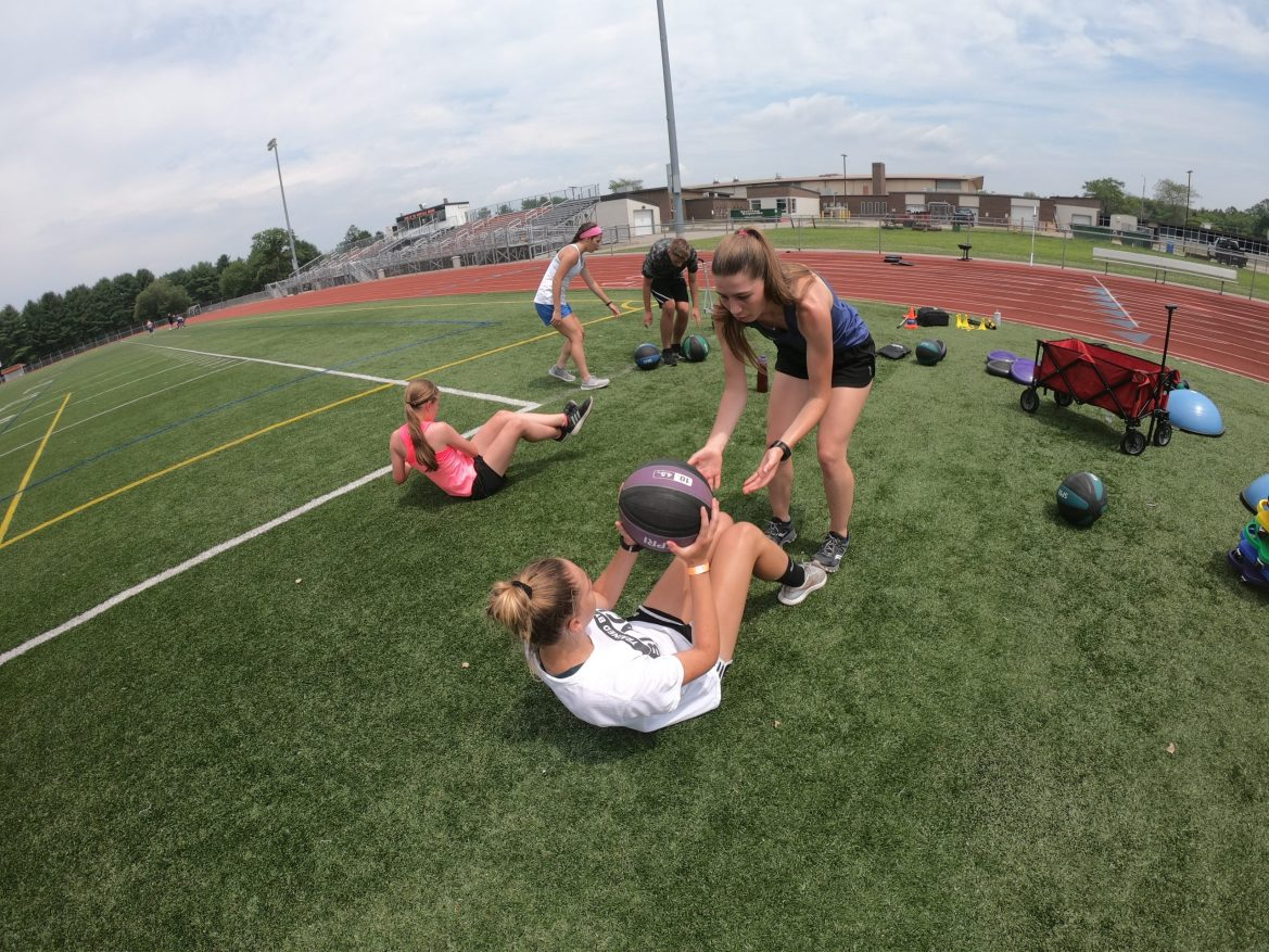 Sisters Crunch with Medicine Ball Toss