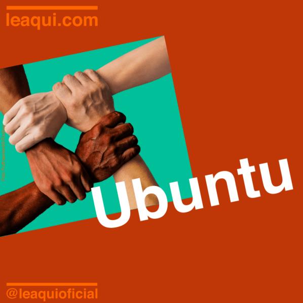 Mãos de quatro pessoas com tons de pele diferentes unidas sob a palavra ubuntu