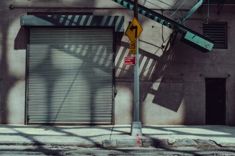 capture one RAW photo editor get creative with color blogpost jesper palermo NYC street view of store with closed shutter