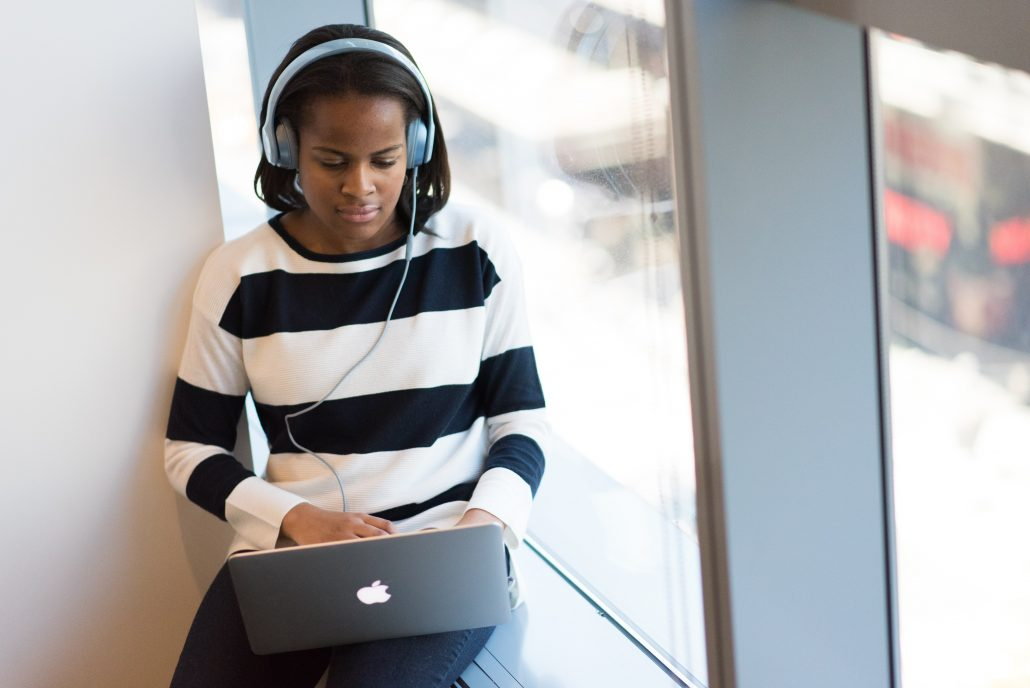 a woman learning python coding