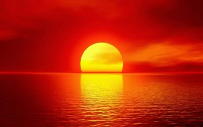 red sun at sunrise and sunset