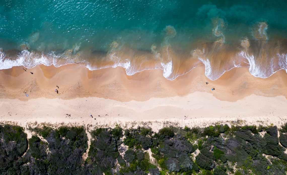 sea washing sandy seaside in resort