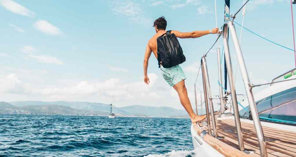 man wearing backpack standing on side of boat during daytime 1223648 1920x1024 1 - Simple English Sentences For Daily Use