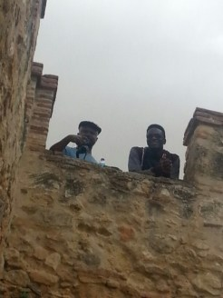 Two of my guys caught photographing me from overhead at the Roman aqueducts in Segovia.