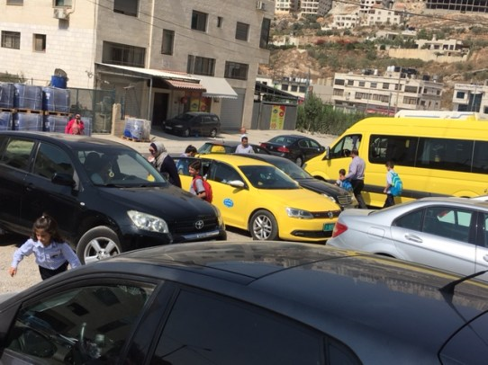 A lof of kids are picked up by taxi drivers.