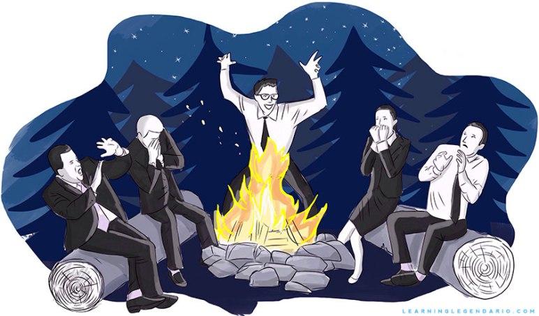 Gente de negocios contanto historias de terror junto al fuego