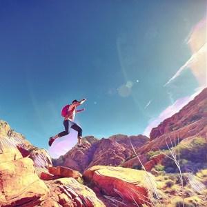 Joven saltando de roca a roca en el desierto