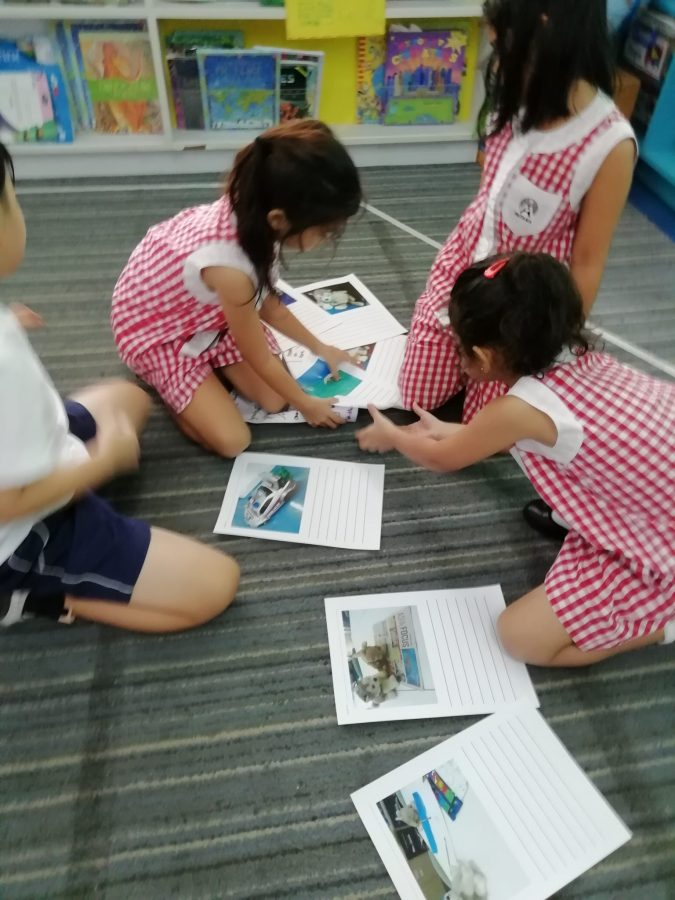 Children collaborating to order story.