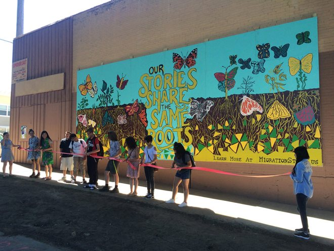 Cutting the ribbon at the opening celebration of our community mural on August 8, 2016.