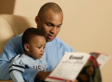 father_son_reading_485595729