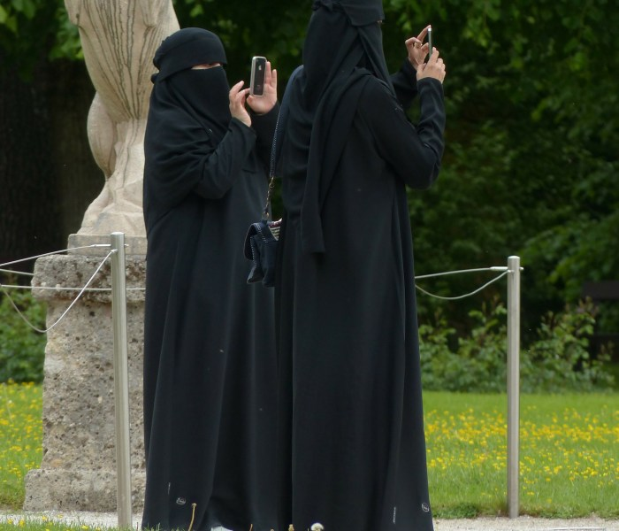 Why does Islam degrade women by keeping them behind the veil?