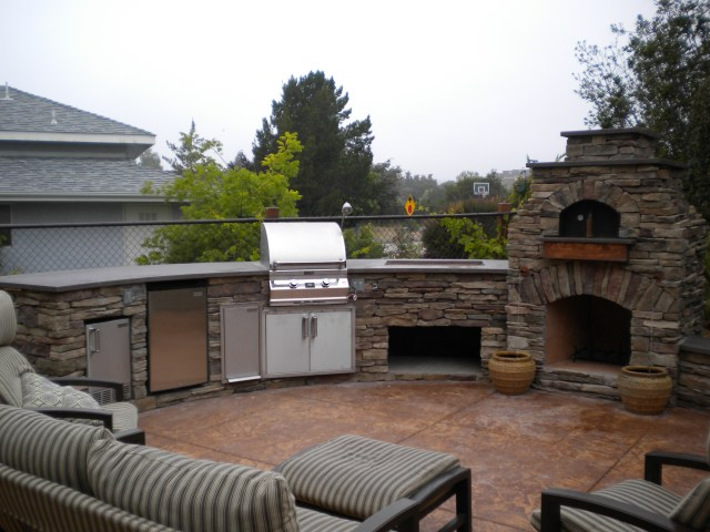 custom arched outdoor kitchen, w/ fire magic appliances. along with