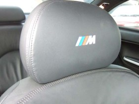 Boom! This headrest pops with colour coded logo.