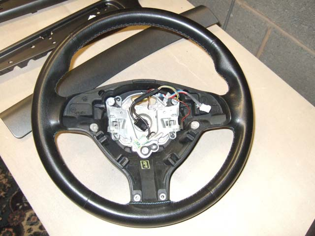 A BMW M3 steering wheel before