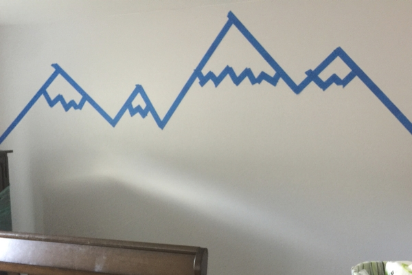 Painters taped mountain mural peaks