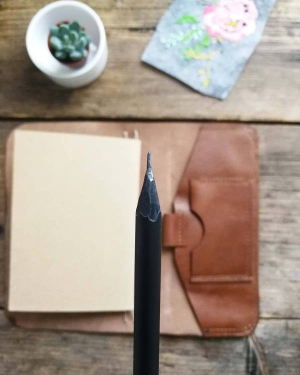 handmade leather journal with design pencil