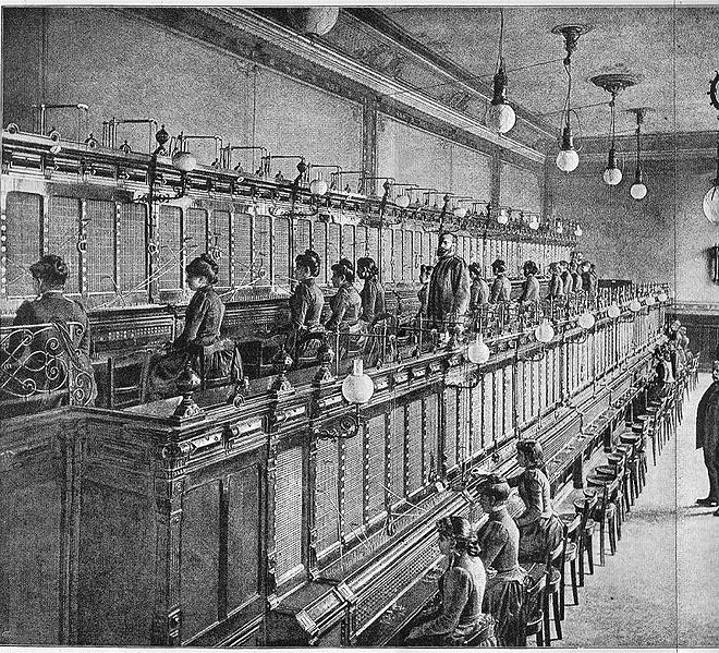"""an historic telephone exchange with two rows of service desks 1893 from the book """"De Electriciteit"""" by P. van Capelle from 1893 Kreuger scanned this picture in october 2007 antique book"""