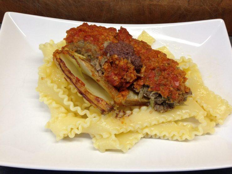 Gefüllter Fenchel  mit Tomatenpesto, Oliven und Mandelparmesan