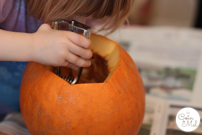 Carving Pumpkins - Beanie Scraping Seeds off