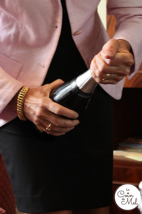 Champagne! How to open a bottle of champagne - hold the bottle firmly with one hand