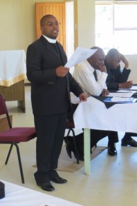 Rev. P. K. Tefo, LECSA Administrator, discusses the church budget