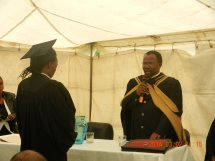Rev. Pule administering the oath