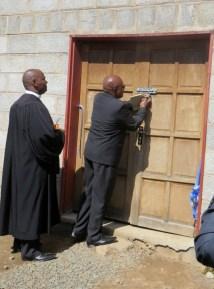 Rev. Sekulisa unlocks the doors