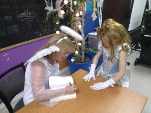 Lee Bice-Matheson with tween dressed as a fairy at the Orillia Youth Centre Halloween Spooktacular, 30/10/14