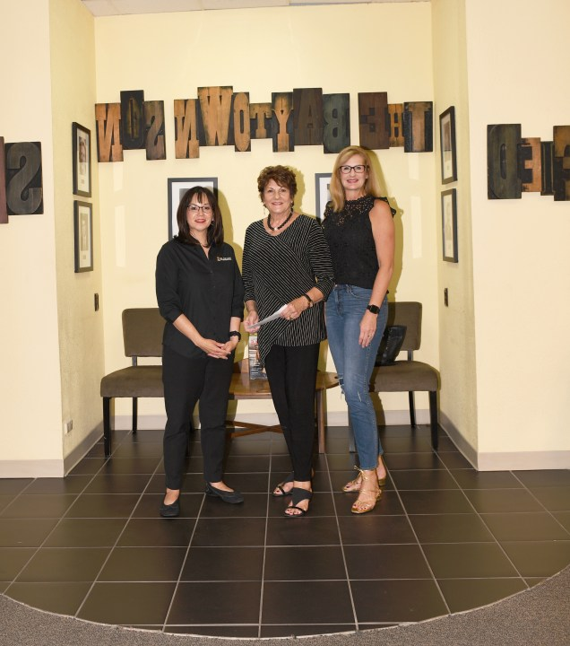 From left, Lee College President Dr. Lynda Villanueva, Kay Eshbach, and Lori Eshbach Comanich. (Photo by The Baytown Sun.)