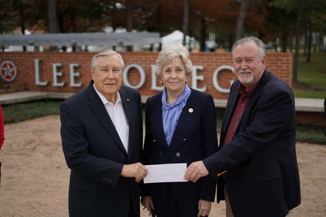 Posed shot of donors with donation check