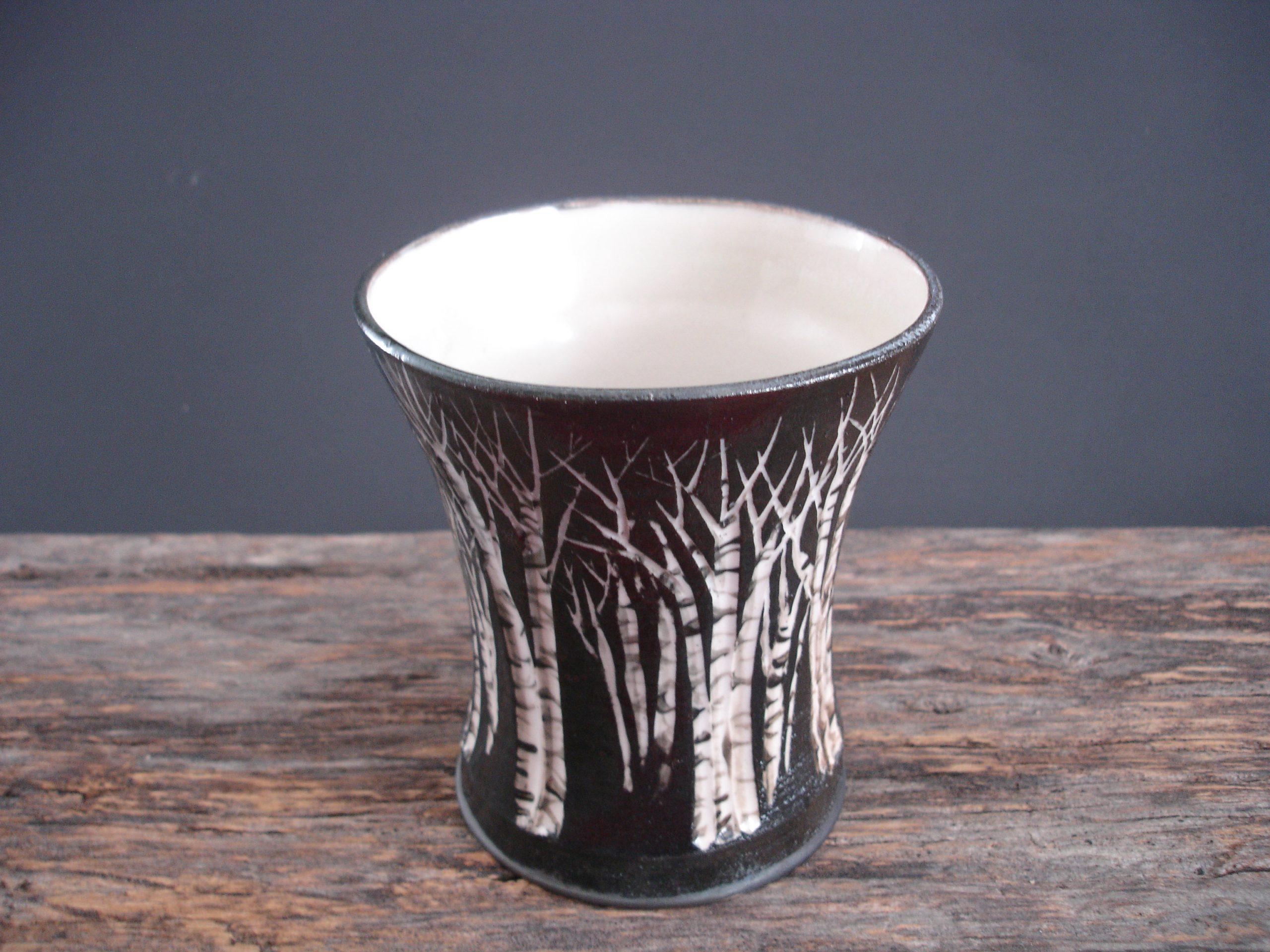 image of a carved pottery tumbler with birch trees