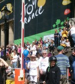 Leed KONP outside the huge Tour De France banner on the front of the Town Hall